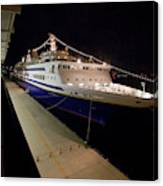 A Cruise Ship At Night Docked Canvas Print