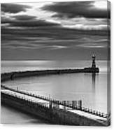 A Curving Pier With A Lighthouse At The Canvas Print