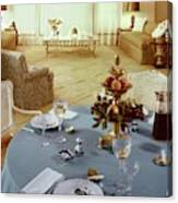 A Dining Room With A Blue Tablecloth And Ornate Canvas Print