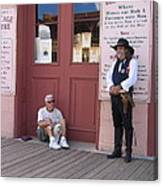 A Dog And A Re-enactor Rest In The Front Of The Bird Cage Theater Tombstone Arizona Canvas Print