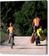 A Father And Son Ride Their Bikes To Go Canvas Print