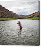A Fly Fisherman Mends While Fishing Canvas Print