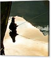 A Fly Fisherman Standing In A River Canvas Print