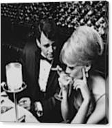 A Glamorous 1960s Couple Dining Canvas Print