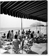 A Group Of People On A Terrace Overlooking Canvas Print