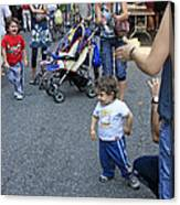 A Little Boy Dancing At The 200th Anniversary Of St. Patrick Old Cathedral Canvas Print