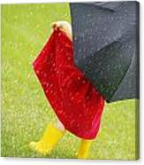 A Little Girl Walking In The Rain While Canvas Print