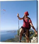 A Male Climber Looking At Paragliding Canvas Print