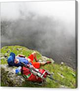 A Male Hiker Is Resting In A Grassy Canvas Print