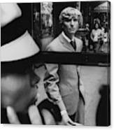 Woman In Telephone Booth Watched By Man Canvas Print