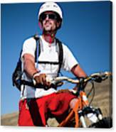 A Male Mountain Biker Stops To Enjoy Canvas Print