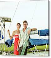 A Man And A Woman Embrace In Sailboat Canvas Print