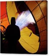 A Man As He Inflates A Hot Air Balloon Canvas Print