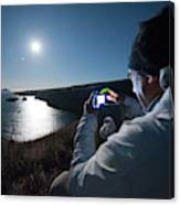 A Man Captures The Full Moon Canvas Print
