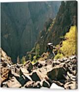 A Man Navigates A Rock Scree Field Canvas Print