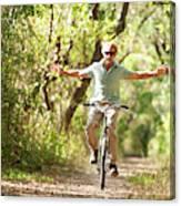 A Man Rides A Bicycle Canvas Print