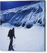 A Man Ski Touring Under Blue Skies Canvas Print