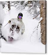 A Man Skiing Powder In The Trees Canvas Print