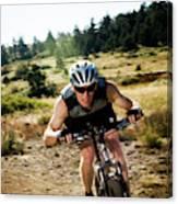 A Man Speeds Down A Trail On A Mountain Canvas Print