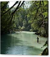 A Man Stands In A River Wearing Waders Canvas Print