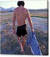 A Man Takes Off His Clothes And Walks Canvas Print