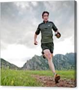 A Man Trail Runs Along The Spring Brook Canvas Print