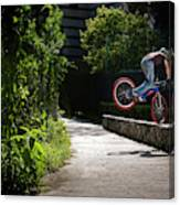A Man With A Bike Standing On The Front Canvas Print