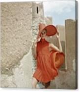 A Model Wearing A Orange Dress Canvas Print