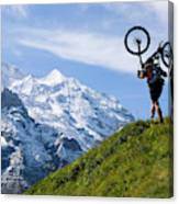 A Mountain Biker Is Carrying His Bike Canvas Print