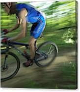 A Mountain Biker Races On A Trail Canvas Print