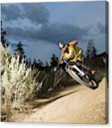 A Mountain Biker Rides A Trail Canvas Print