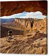 A Mountain Biker Rides By On Slickrock Canvas Print