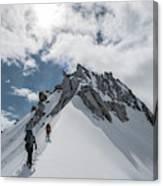 A Rope Team Climbs A Ridge Canvas Print