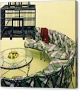 A Round Couch And A Birdcage Canvas Print