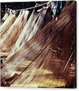 A Row Of Mosquito Netting Over Sleeping Canvas Print