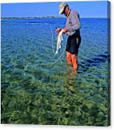 A Salt Water Fly Fisherman Catches Canvas Print
