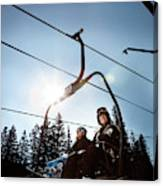 A Skier And Snowboarder Share The Chair Canvas Print