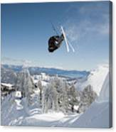 A Skier Doing A Front Flip Into Powder Canvas Print