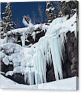 A Snowboarder Jumps Off An Ice Canvas Print