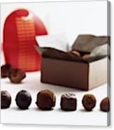 A Still Life Photo Of Gourmet Chocolates Canvas Print
