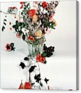 A Studio Shot Of A Vase Of Flowers And A Garden Canvas Print