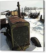 A Tractor In The Snow Canvas Print