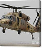 A Uh-60l Yanshuf Helicopter Landing Canvas Print