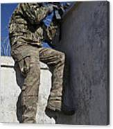 A U.s. Soldier Provides Security At An Canvas Print