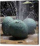 A Water Fountain With Dinosaur Eggs In The Universal Studios Singapore Canvas Print