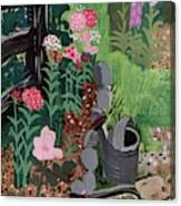 A Watering Can And A Shovel By A Flower Bed Canvas Print