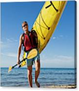 A Woman Carrying Her Sea Kayak Canvas Print