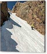 A Woman Descending A Snow Slope While Canvas Print