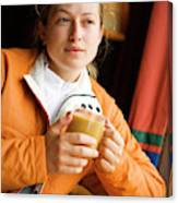 A Woman Enjoys A Warm Cup Of Cocoa Canvas Print