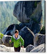 A Woman Hiking High In The Mountains Canvas Print
